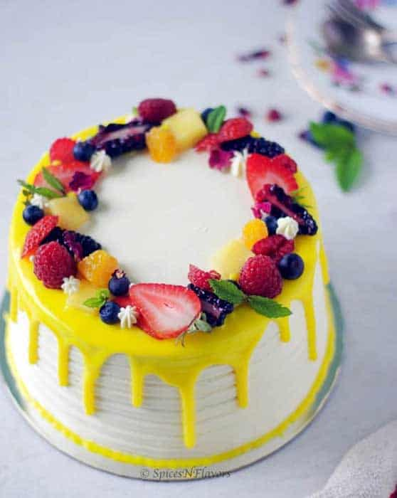 Decorate a cake with fruits