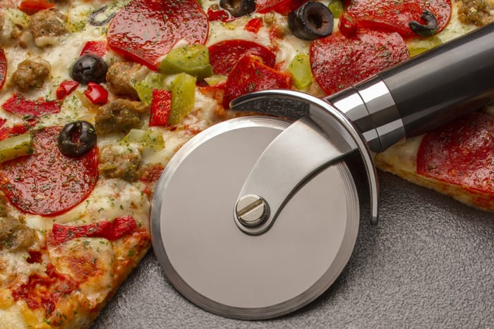 Cut a pizza into 6 slices Using a circular metal cutter