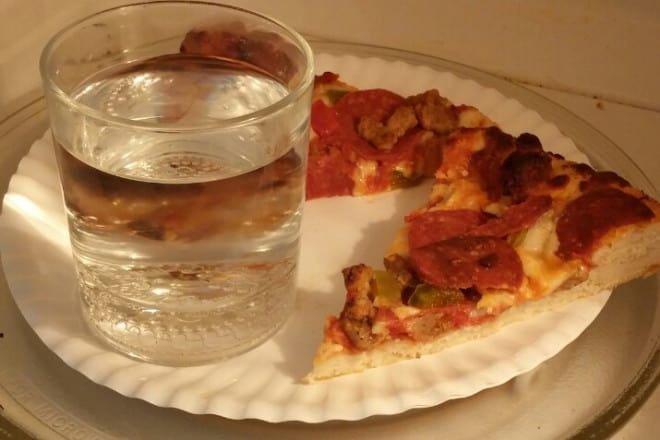 Reheat a pizza in a microwave oven