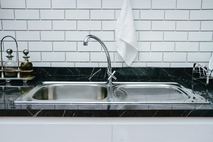 How do you remove rust from a stainless steel sink
