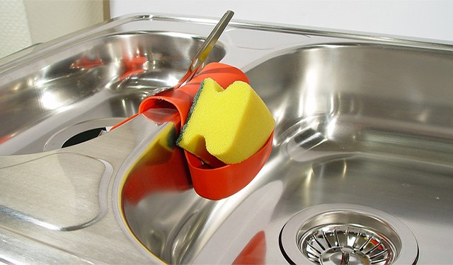 Use commercial rust removers on stainless steel sink