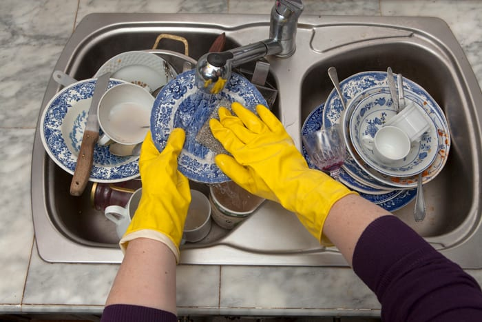 wash dishes in a farmhouse sink